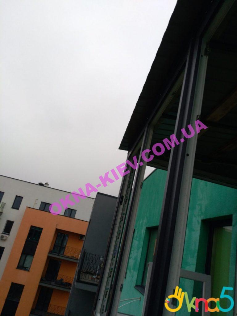 Остекление балкона с крышей ЖК Европейка на ул. Соборности 103/9 фото ОКна 5